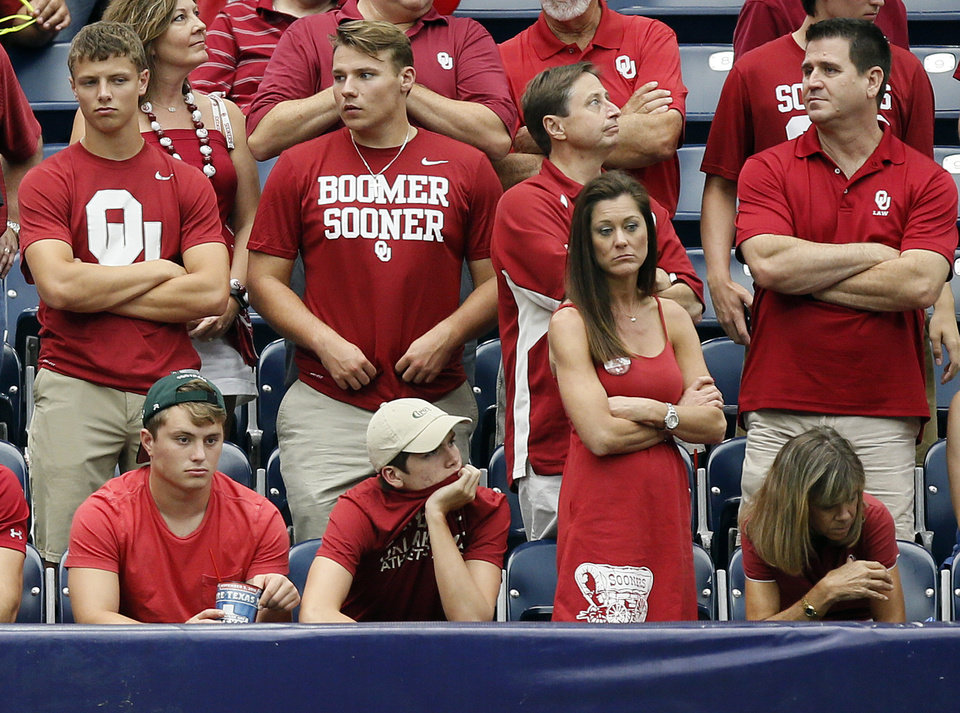 Photo - OU fans appear dejected late in the AdvoCare Texas Kickoff college football game between the University of Oklahoma Sooners (OU) and the Houston Cougars at NRG Stadium in Houston, Saturday, Sept. 3, 2016. Houston won 33-23. Photo by Nate Billings, The Oklahoman