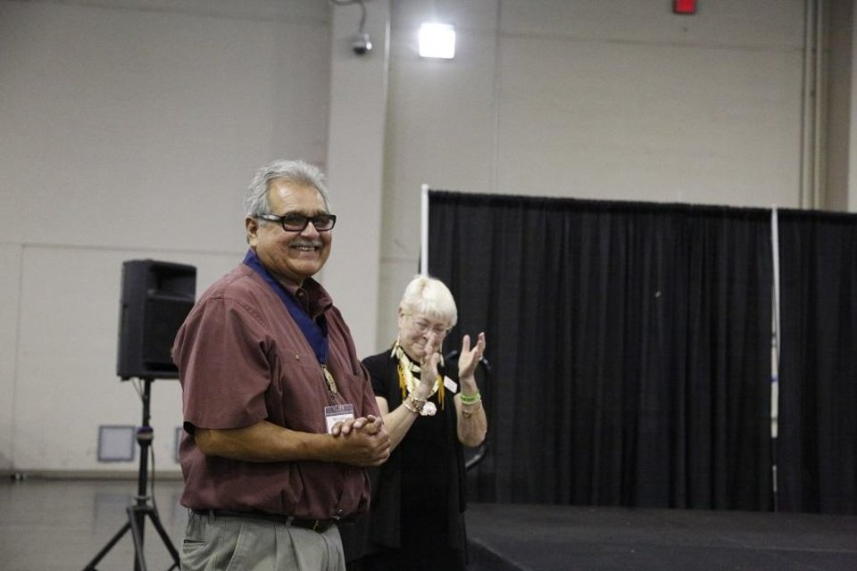 Photo - Clancy Gray, the 2019 Red Earth Honored One, is recognized during the 2019 Red Earth Festival at the Cox Convention Center in Oklahoma City, Oklahoma Friday, June 7, 2019. At right is Teri Stanek, past president of the Red Earth board. [Paxson Haws/The Oklahoman]