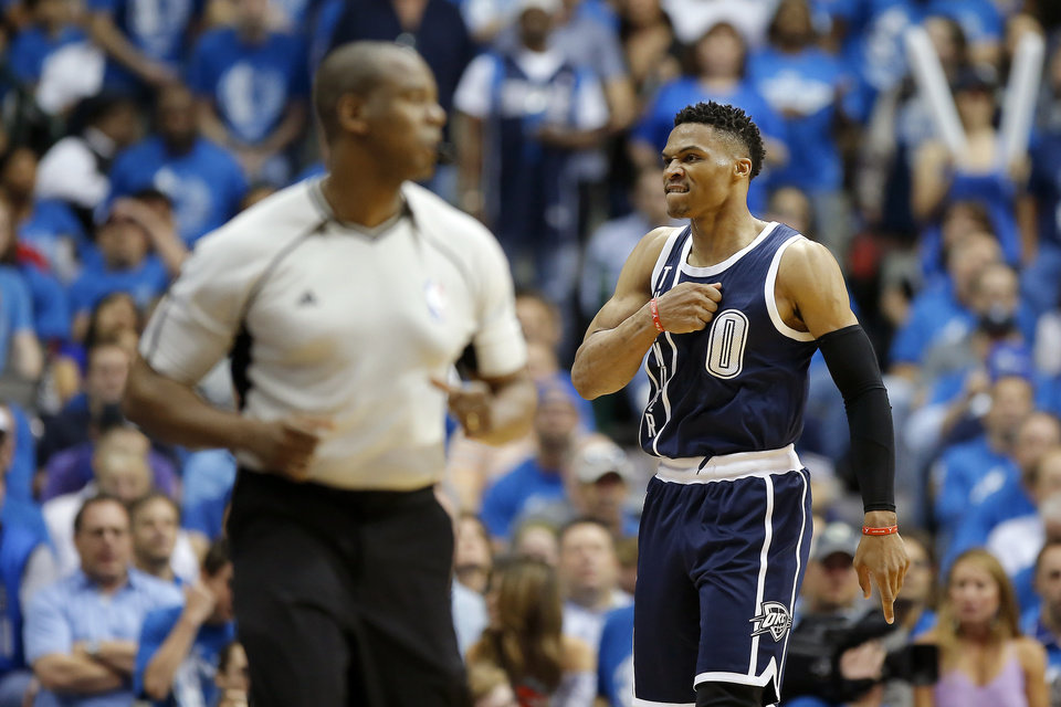 Photo - Oklahoma City's Russell Westbrook (0) celebrates a basket during Game 3 of the first round series between the Oklahoma City Thunder and the Dallas Mavericks in the NBA playoffs at American Airlines Center in Dallas, Thursday, April 21, 2016. The Thunder won 131-102. Photo by Bryan Terry, The Oklahoman