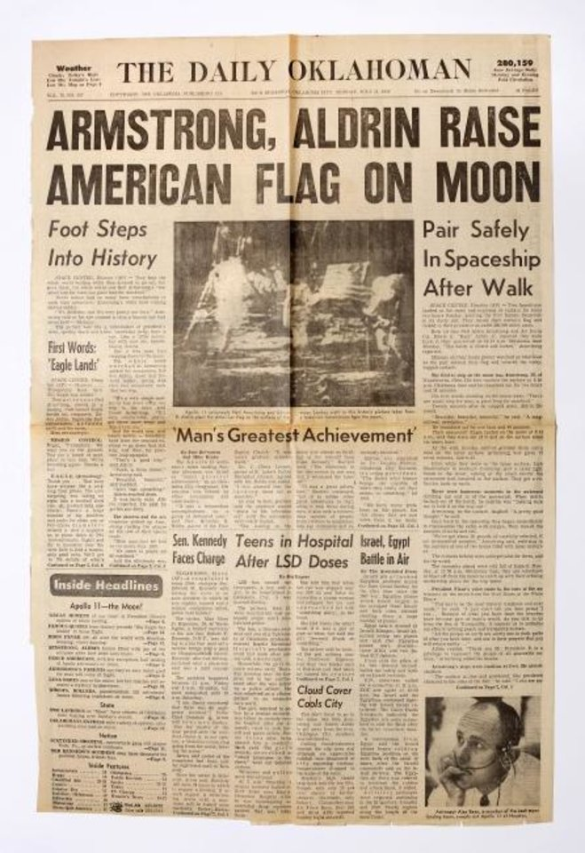 Photo -  Front page of July 21, 1969, edition of The Daily Oklahoman, with coverage of United States astronauts landing and walking on the surface of the moon.   [Jim Beckel/The Oklahoman]