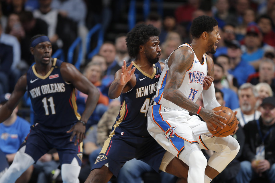 Photo - Oklahoma City's Paul George (13) tries to get past New Orleans' Solomon Hill (44) during an NBA basketball game between the Oklahoma City Thunder and the New Orleans Pelicans at Chesapeake Energy Arena in Oklahoma City, Thursday, Jan. 24, 2019. Photo by Bryan Terry, The Oklahoman