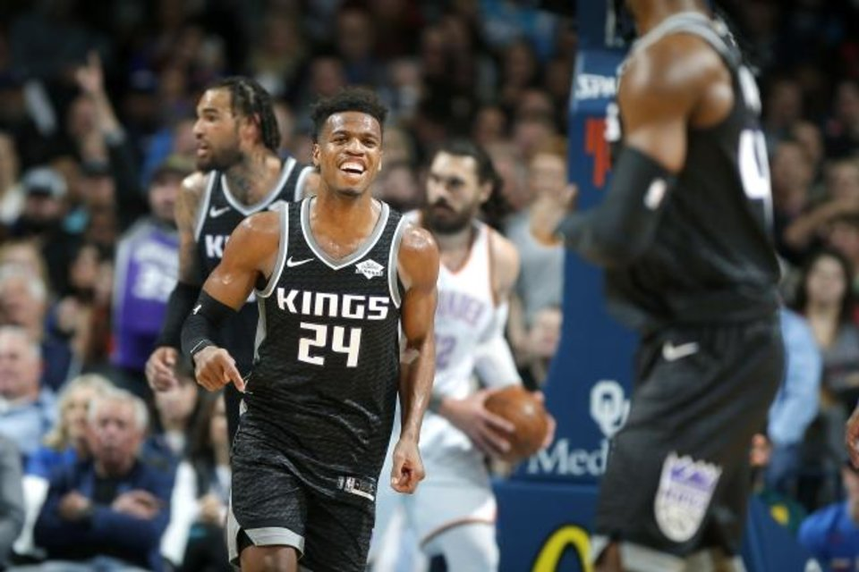 Photo -  Sacramento's Buddy Hield smiles during a game against Oklahoma City in February 2019 at Chesapeake Energy Arena  [Bryan Terry/The Oklahoman]