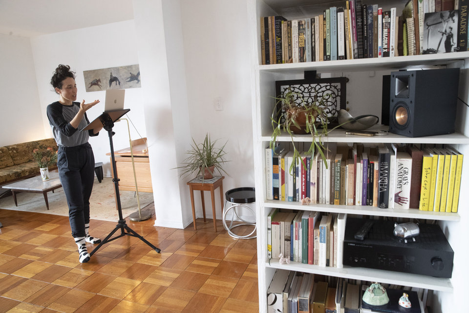 Photo -  FILE - In this Thursday, April 23, 2020, photo dancer choreographer Netta Yerushalmy speaks to the other participants on her computer during a Zoom meeting dance rehearsal in her living room on the Lower East Side neighborhood of New York. Many artists like Yerushalmy have turned to social media to get their work out during the coronavirus pandemic, posting music and artwork on Instagram. (AP Photo/Mary Altaffer)
