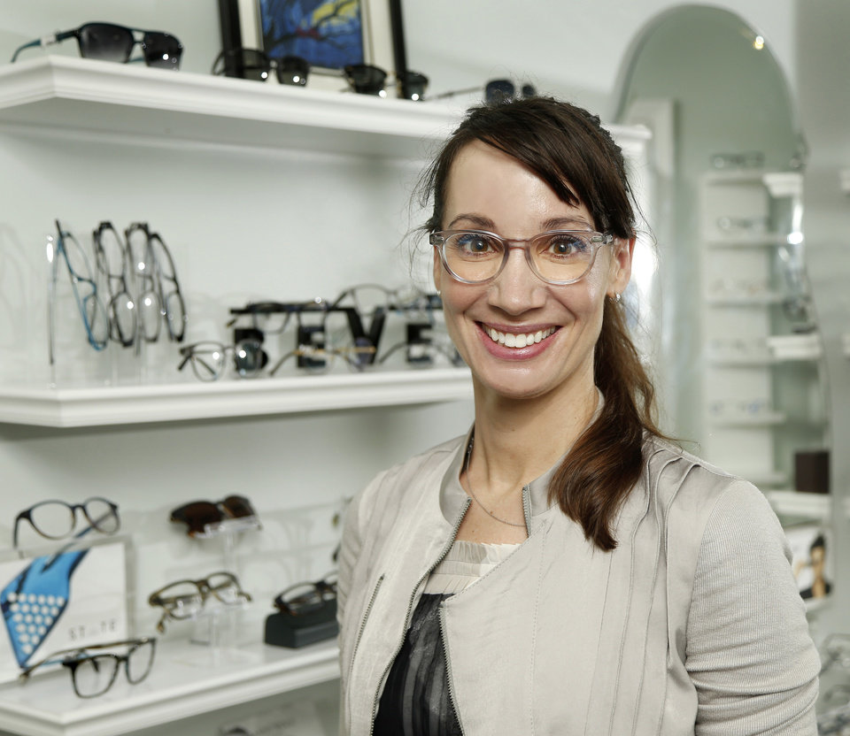 Photo -  Selina R. McGee, president-elect of the Oklahoma Association of Optometric Physicians, displays eyeglasses in her clinic at 501 E 15th in Edmond. [PHOTO BY JIM BECKEL, THE OKLAHOMAN]