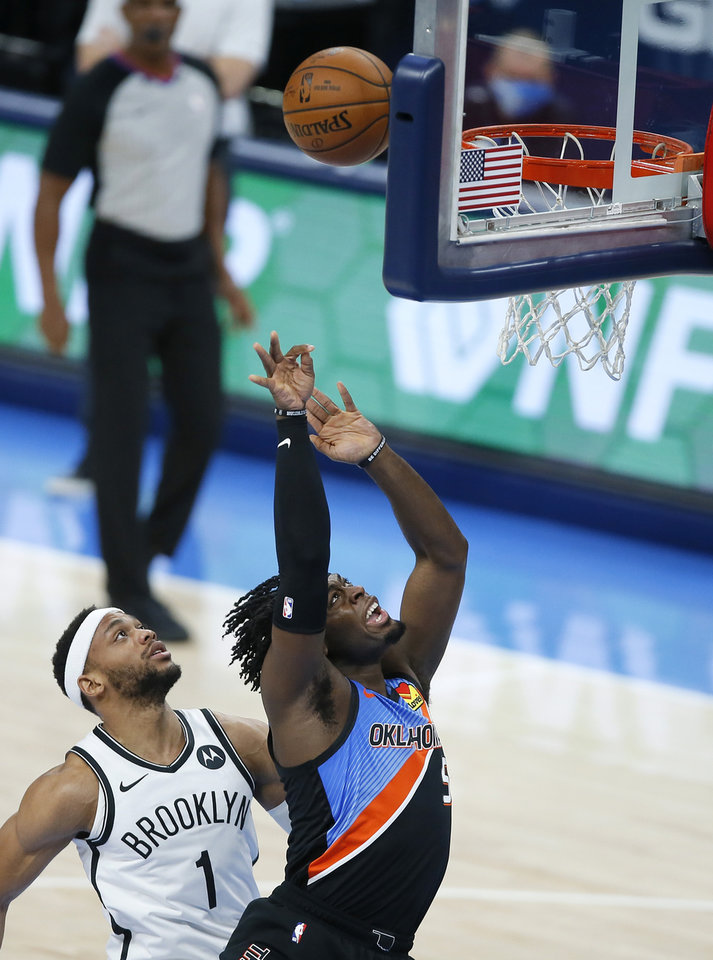 Photo - Oklahoma City's Luguentz Dort (5) puts up a shot beside Brooklyn's Bruce Brown (1) during an NBA basketball game between the Oklahoma City Thunder and the Brooklyn Nets at Chesapeake Energy Arena in Oklahoma City, Friday, Jan. 29, 2021. [Bryan Terry/The Oklahoman]