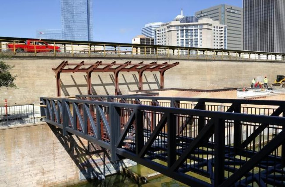 Photo -  Improvements underway on the north end of the Bricktown Canal include a pedestrian bridge, stairway and shade structures. [Jim Beckel/The Oklahoman]