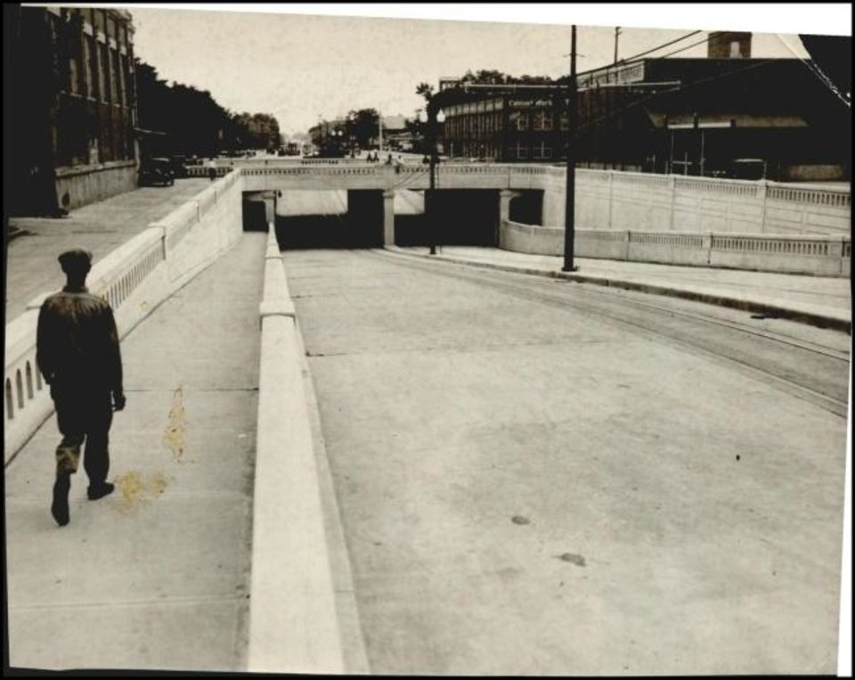Photo -  A completed underpass takes Walker Avenue traffic under the relocated tracks. [THE OKLAHOMAN ARCHIVES]