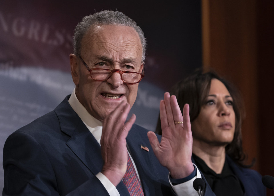 Photo -  Senate Minority Leader Chuck Schumer, D-N.Y., joined by Sen. Kamala Harris, D-Calif., right, speaks to reporters to criticize the process in the Republican-controlled Senate as the impeachment trial of President Donald Trump on charges of abuse of power and obstruction of Congress, resumes in Washington, Friday, Jan. 31, 2020. (AP Photo/J. Scott Applewhite)