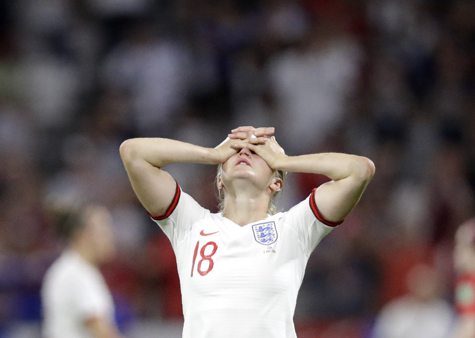 Photo - England's Ellen White covers her face at the end of the Women's World Cup semifinal soccer match between England and the United States, at the Stade de Lyon, outside Lyon, France, Tuesday, July 2, 2019. (AP Photo/Alessandra Tarantino)