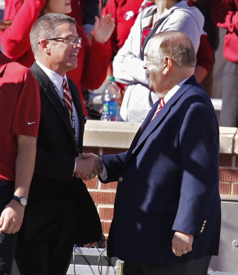 Photo - Brian A. Britt new Director of The Pride of Oklahoma Band shakes hands with OU president David Boren after directing the band before the college football game between the University of Oklahoma Sooners (OU) and The Baylor University Bears (BU) at Gaylord Family-Oklahoma Memorial Stadium in Norman, Okla. on Saturday, Nov. 8, 2014.  Photo by Steve Sisney, The Oklahoman