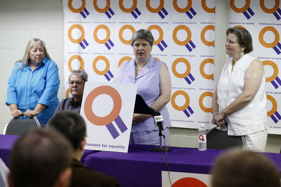 Photo - Sharon Baldwin speaks at a press conference at the Dennis R. Neill Equality Center in Tulsa, Okla. with Mary Bishop (right), Gay Phillips (left) and Sue Barton (seated) on Monday, October 6, 2014. MATT BARNARD/Tulsa World