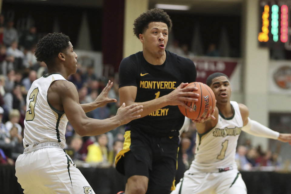 Photo - Montverde Academy's Cade Cunningham #1 in action against Holy Spirit during a high school basketball game at the Hoophall Classic, Saturday, January 19, 2019, in Springfield, MA. (AP Photo/Gregory Payan)