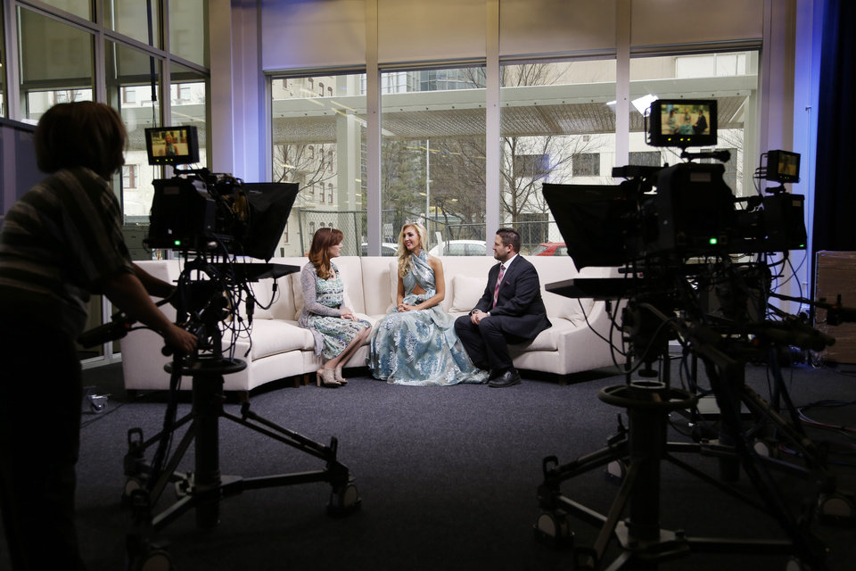 Photo -  Heather Warlick, left, of The Oklahoman, interviews Miss Edmond LibertyFest Sarah Klein and Brent Patterson, director of public relations and marketing at Marianne's Rentals, about the 2015 Linen Runway Show. They are pictured in The Oklahoman's video studio. To watch the video, go online to NewsOk.com. Photo by Doug Hoke, The Oklahoman   DOUG HOKE -  THE OKLAHOMAN