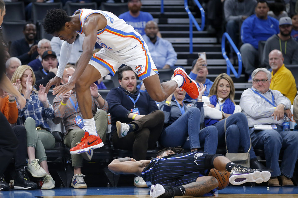 Photo - Oklahoma City's Shai Gilgeous-Alexander (2) leaps over Orlando's Markelle Fultz (20) during an NBA basketball game between the Oklahoma City Thunder and the Orlando Magic at Chesapeake Energy Arena in Oklahoma City, Tuesday, Nov. 5, 2019. Oklahoma City won 102-94. [Bryan Terry/The Oklahoman]