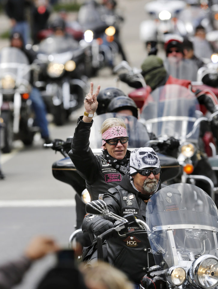 Photo - Motorcyclists from across the country, numbering more than 1,000 strong, rumbled through the downtown streets of Oklahoma City on Saturday, April, 22, 2017,  taking part in  the 10th annual Ride to Remember.  The annual benefit run honors the 168 people killed in the April 19, 1995 bombing of the Alfred P. Murrah Federal Building. All funds raised go toward the Oklahoma City National Memorial and Museum, which operates solely on private donations. Bikers rolled out for the first event in 2007.    Photo by Jim Beckel, The Oklahoman