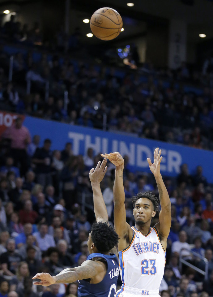 Photo - Oklahoma City's Terrance Ferguson (23) shoots a 3-point basket in front of Minnesota's Jeff Teague (0) during the NBA game between the Oklahoma City Thunder and Minnesota Timberwolves at the Chesapeake Energy Arena, Tuesday, Jan. 8, 2019. Photo by Sarah Phipps, The Oklahoman