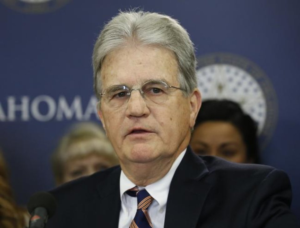 Photo - Former U.S. Sen. Tom Coburn speaks at a news conference in Oklahoma City, Wednesday, March 28, 2018. Coburn announced his support of an anti-tax group Oklahoma Taxpayers Unite. The group is considering launching a signature drive to overturn any major tax hikes signed by the governor. (AP Photo/Sue Ogrocki)