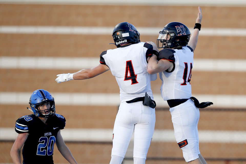 Photo - Norman's Cade Horton, right, celebrates with Jonah Paden after scoring a touchdown during a high school football game between Deer Creek and Norman at Deer Creek High School, Friday, Sept. 13, 2019. [Bryan Terry/The Oklahoman]
