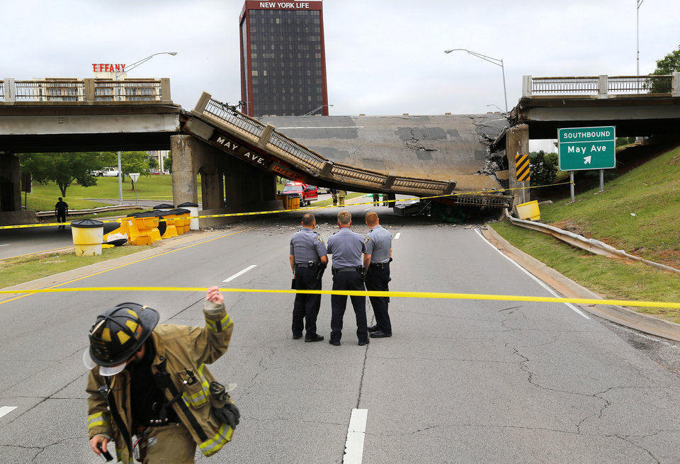 Photo - A section of the May Ave. bridge above the Northwest Expressway collapsed when  it was hit by a truck Thursday afternoon, in  Oklahoma City. No injuries were reported. This view is looking west. Photo by Jim Beckel, The Oklahoman.