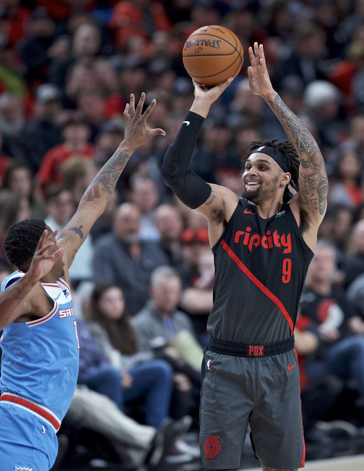 Photo - Portland Trail Blazers guard Gary Trent Jr. shoots over Sacramento Kings forward Troy Williams during the second half of an NBA basketball game in Portland, Ore., Wednesday, April 10, 2019. (AP Photo/Craig Mitchelldyer)
