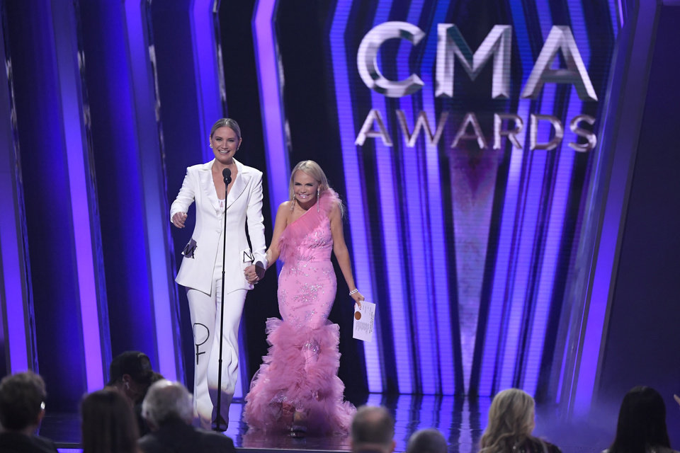 Photo - Jennifer Nettles, left, and Kristin Chenoweth present the the award for song of the year at the 53rd annual CMA Awards at Bridgestone Arena on Wednesday, Nov. 13, 2019, in Nashville, Tenn. (AP Photo/Mark J. Terrill)