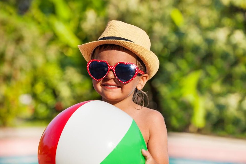Photo - Summer is here and kids are out of school for summer break. While you are enjoying the sun, taking precautions to protect your kids from the harmful rays will pose some long-term benefits. (DepositPhotos)