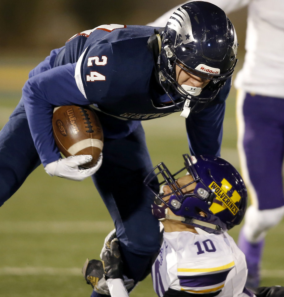 Photo - Tulsa Metro Christian's Blaze Munoz is brought down by Vian's Diego Ramos during the Class 2A football state championship game between Tulsa Metro Christian and Vian at Wantland Stadium in Edmond, Okla., Saturday, Dec. 14, 2019. [Bryan Terry/The Oklahoman]