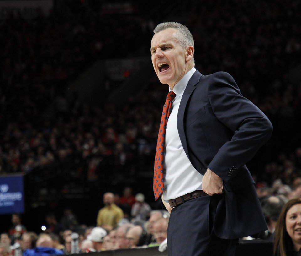 Photo - Oklahoma City Thunder head coach Billy Donovan shouts instructions during the second half of Game 1 of a first-round NBA basketball playoff series against the Portland Trail Blazers in Portland, Ore., Sunday, April 14, 2019. (AP Photo/Steve Dipaola)