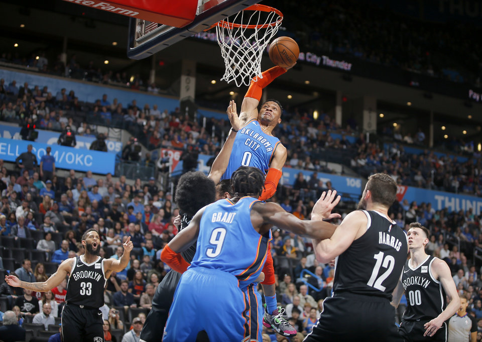 Photo - Oklahoma City's Russell Westbrook (0) misses a dunk during an NBA basketball game between the Oklahoma City Thunder and the Brooklyn Nets at Chesapeake Energy Arena in Oklahoma City, Wednesday, March 13, 2019. Oklahoma City won 108-96. Photo by Bryan Terry, The Oklahoman