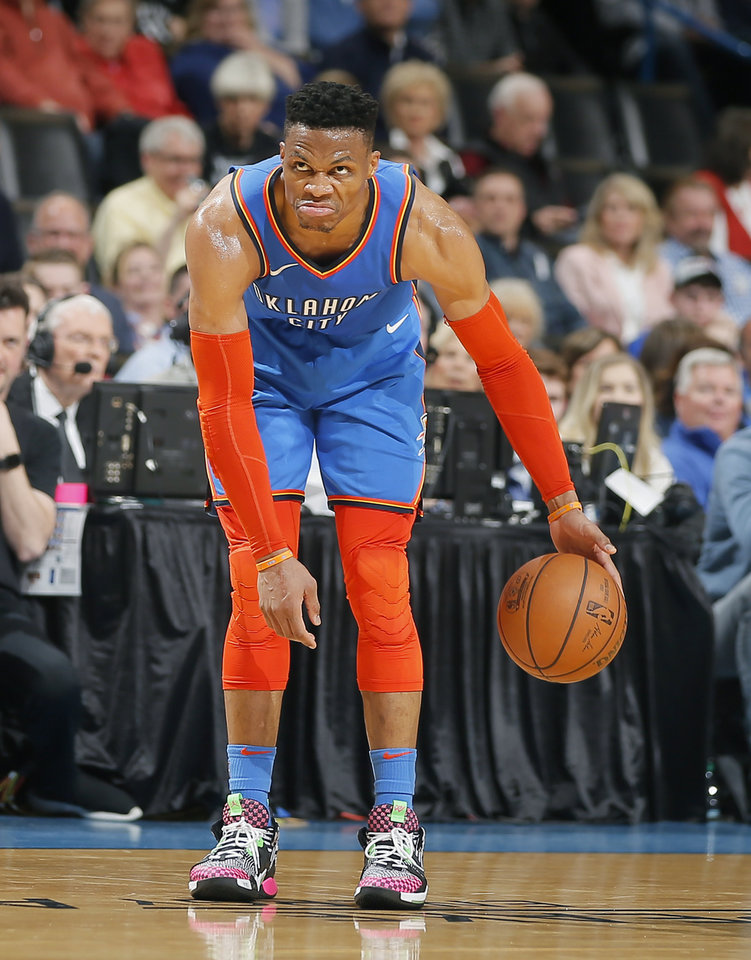Photo - Oklahoma City's Russell Westbrook (0) looks towards the basket as he dribbles the ball during an NBA basketball game between the Oklahoma City Thunder and the Brooklyn Nets at Chesapeake Energy Arena in Oklahoma City, Wednesday, March 13, 2019. Oklahoma City won 108-96. Photo by Bryan Terry, The Oklahoman