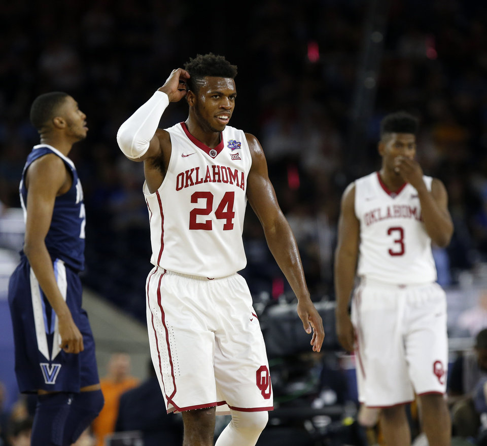 Photo - Oklahoma's Buddy Hield (24) reacts after an OU turnover during the national semifinal between the Oklahoma Sooners (OU) and the Villanova Wildcats in the Final Four of the NCAA Men's Basketball Championship at NRG Stadium in Houston, Saturday, April 2, 2016. Photo by Nate Billings, The Oklahoman