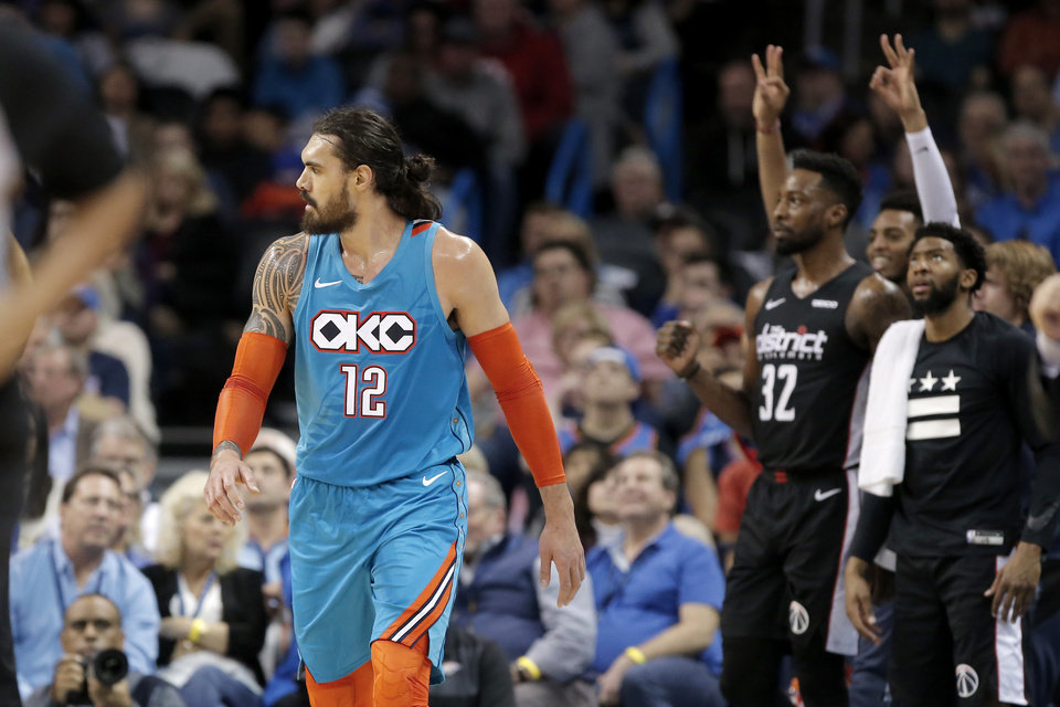Photo - The Washington bench celebrates a 3-pointer behind Oklahoma City's Steven Adams (12) during an NBA basketball game between the Oklahoma City Thunder and the Washington Wizards at Chesapeake Energy Arena in Oklahoma City, Sunday, Jan. 6, 2019. Photo by Bryan Terry, The Oklahoman