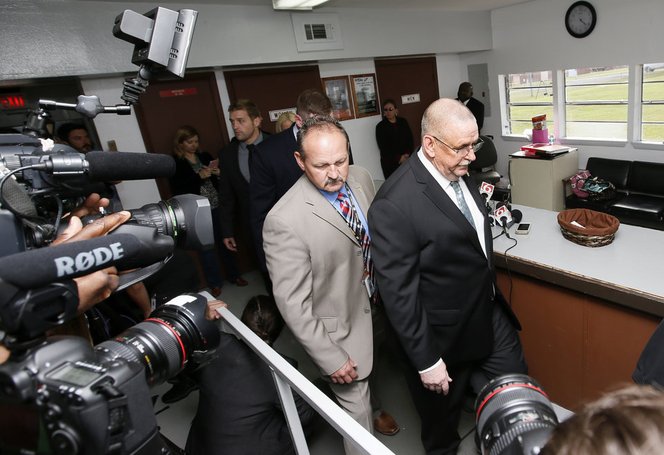 Photo - Robert Patton, director of the Department of Corrections, leaves the media center after addressing the media when the scheduled execution of Richard Eugene Glossip was stayed at the Oklahoma State Penitentiary in McAlester, Okla., Wednesday, Sept. 30, 2015. Gov. Fallin stayed the execution for 37 days. Photo by Nate Billings, The Oklahoman
