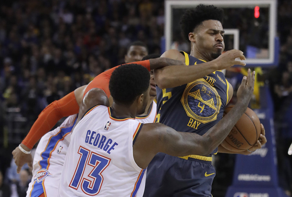 036f664b5 ... is defended by Oklahoma City Thunder forward Paul George (13) and guard Russell  Westbrook