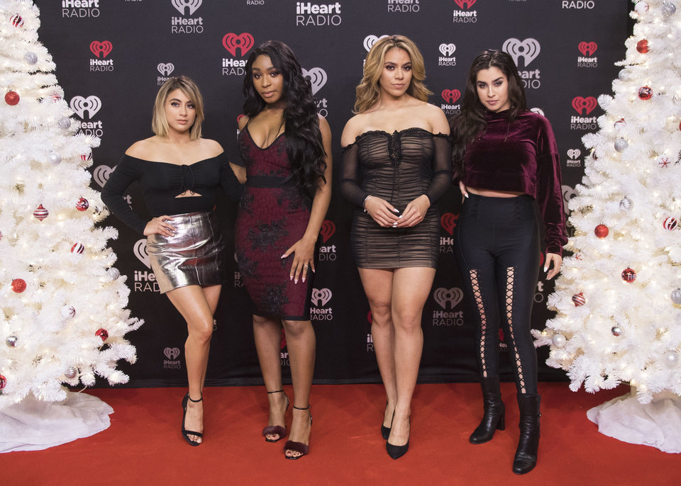 fifth harmony poses for a photo during the 2017 iheartradio jingle ball north at the air