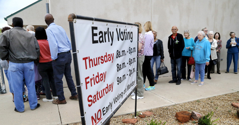 Photo - Hundreds of people stood in a line that extended into the parking lot of the Oklahoma County Election Board office on Thursday morning, waiting to cast their ballots on the first day of in-person early voting. [Photo by Jim Beckel, The Oklahoman]