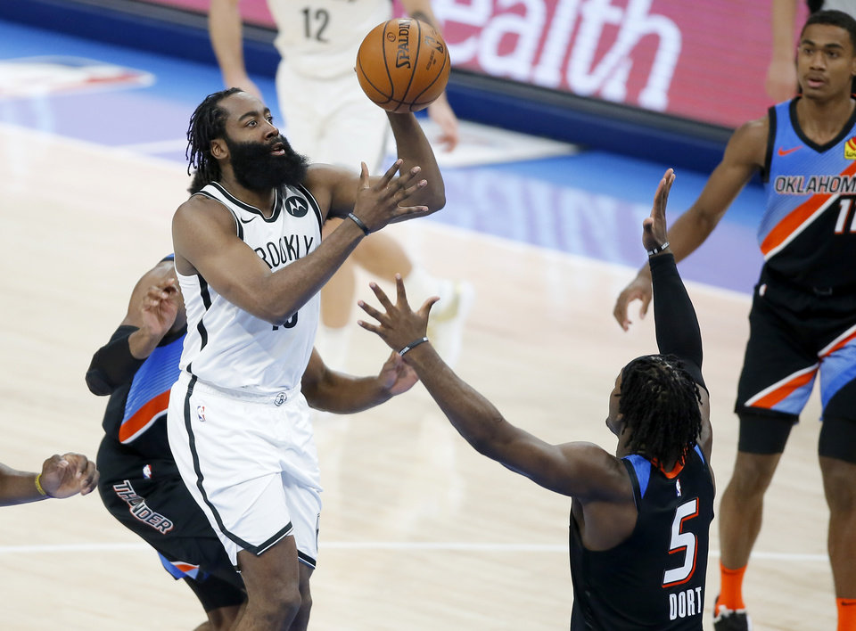 Photo - James Harden (13) puts p a shot over Oklahoma City's Luguentz Dort (5) during an NBA basketball game between the Oklahoma City Thunder and the Brooklyn Nets at Chesapeake Energy Arena in Oklahoma City, Friday, Jan. 29, 2021. [Bryan Terry/The Oklahoman]