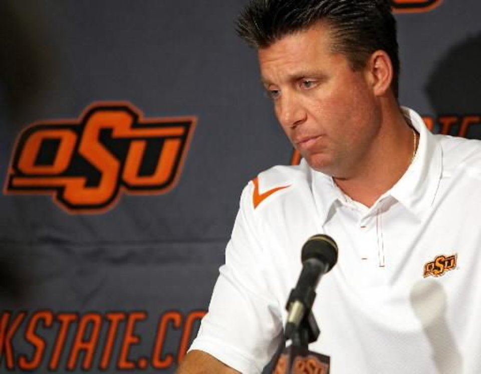 Photo - Oklahoma State head coach  Mike  Gundy speaks to the media at Oklahoma State University in Stillwater, Okla., on Saturday, August 8, 2009. By John Clanton