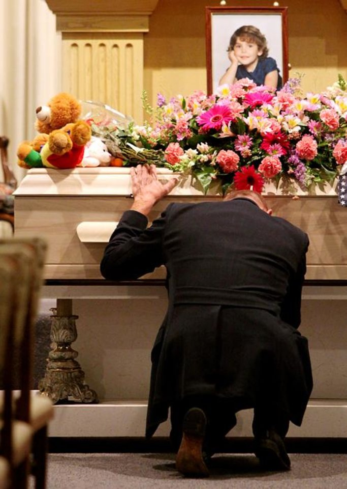 Photo -  J.J. Johnson kneels in front of his daughter Aja Johnson's casket during her funeral at Vondel L. Smith and Son's South Colonial Chapel in Oklahoma City on Wednesday, April 7, 2010. Photo by John Clanton, The Oklahoman ORG XMIT: KOD