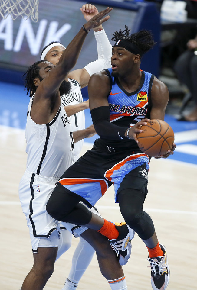 Photo - Oklahoma City's Luguentz Dort (5) passes the ball as Brooklyn's James Harden (13) defends during an NBA basketball game between the Oklahoma City Thunder and the Brooklyn Nets at Chesapeake Energy Arena in Oklahoma City, Friday, Jan. 29, 2021. [Bryan Terry/The Oklahoman]