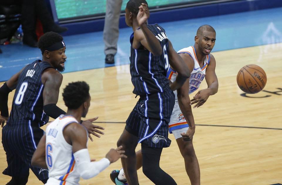 Photo - Oklahoma City's Chris Paul (3) passes the ball to Hamidou Diallo (6) during an NBA basketball game between the Oklahoma City Thunder and the Orlando Magic at Chesapeake Energy Arena in Oklahoma City, Tuesday, Nov. 5, 2019. Oklahoma City won 102-94. [Bryan Terry/The Oklahoman]
