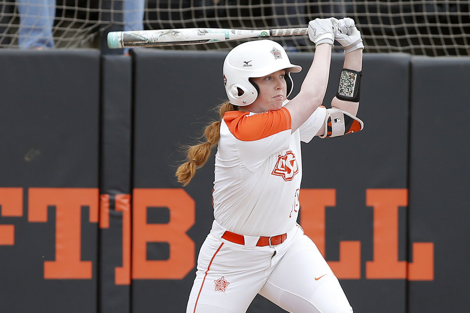 Photo - Oklahoma State's Chelsea Alexander (55) drives in a run in the fourth inning of the Stillwater Regional NCAA softball tournament game between Oklahoma State University (OSU) and Tulsa in Stillwater, Okla., Saturday, May 18, 2019. Oklahoma State won 2-1. [Bryan Terry/The Oklahoman]