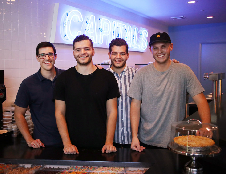 Photo -  Partners Eric Gilbert, Layne Ferguson, Landon Ferguson and Connor Cox opened their first Capitals Ice Cream at 1006 N Hudson Ave. with dreams of going national with the concept. [Photo by Doug Hoke,The Oklahoman]