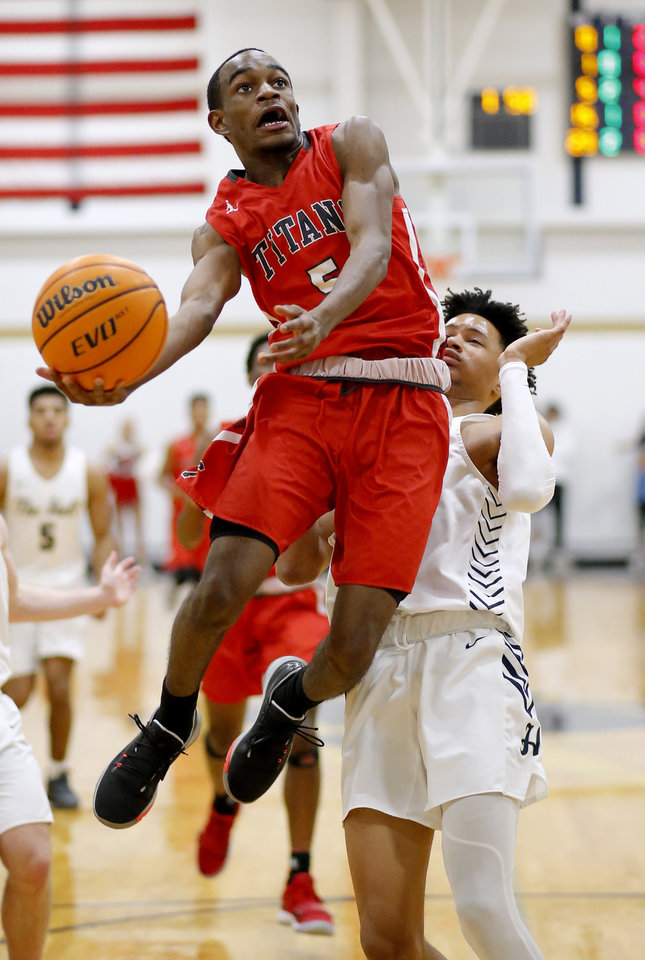 Photo - Carl Albert's Curtis Rose goes up for a lay up as Heritage Hall's Trey Alexander defends during the high school boys game between Heritage Hall and  Carl Albert at Heritage Hall in Oklahoma City, Friday, Jan. 17, 2020.  [Sarah Phipps/The Oklahoman]