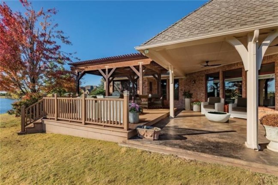 Photo -  Back view of the Listing of the Week, at 21850 Water Oak Circle in Edmond. [PHOTO PROVIDED]