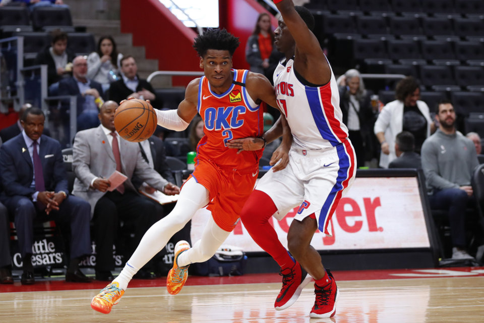 Photo - Oklahoma City Thunder guard Shai Gilgeous-Alexander (2) drives on Detroit Pistons forward Tony Snell (17) in the second half of an NBA basketball game in Detroit, Wednesday, March 4, 2020. (AP Photo/Paul Sancya)