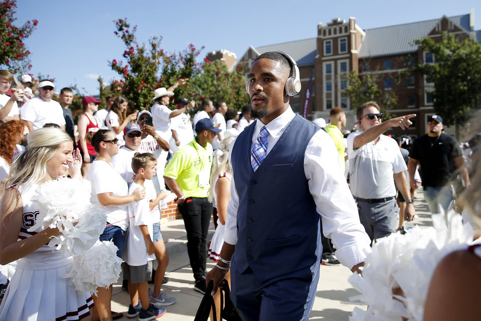 Photo - Oklahoma's Jalen Hurts walks to the stadium with the team prior a college football game between the University of Oklahoma Sooners (OU) and the Houston Cougars at Gaylord Family-Oklahoma Memorial Stadium in Norman, Okla., Sunday, Sept. 1, 2019. [Bryan Terry/The Oklahoman]