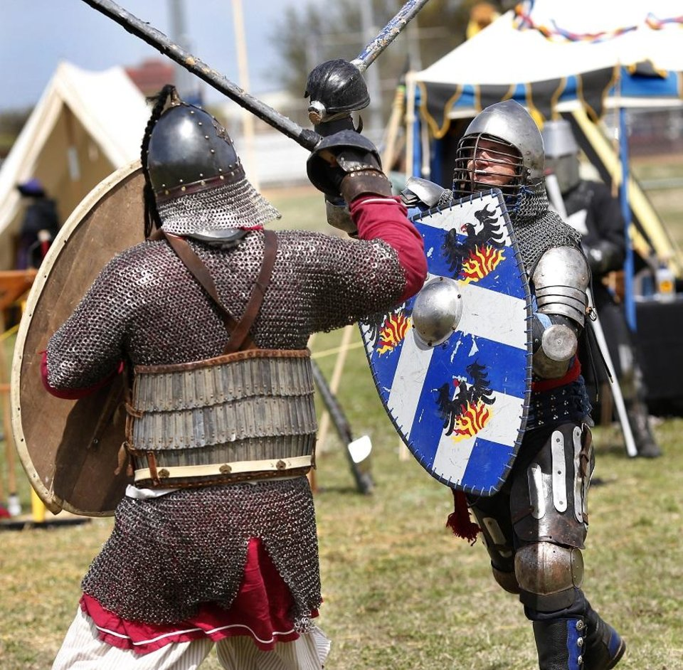 Photo - Members of the Society for Creative Anachronism stage armored combat sessions that depict chivalric fighting styles employed by knights at the 2019 Medieval Fair of Norman in Reaves Park on Friday, April 5, 2019.  [The Oklahoman Archives]