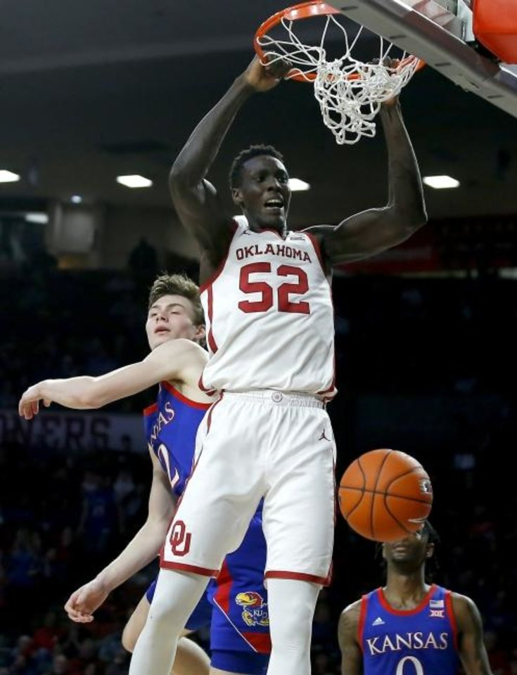 Photo -  Oklahoma forward Kur Kuath (52) is averaging 3.4 points in 10.2 minutes per game this season after missing most of last season with a back injury.  [Bryan Terry/The Oklahoman]