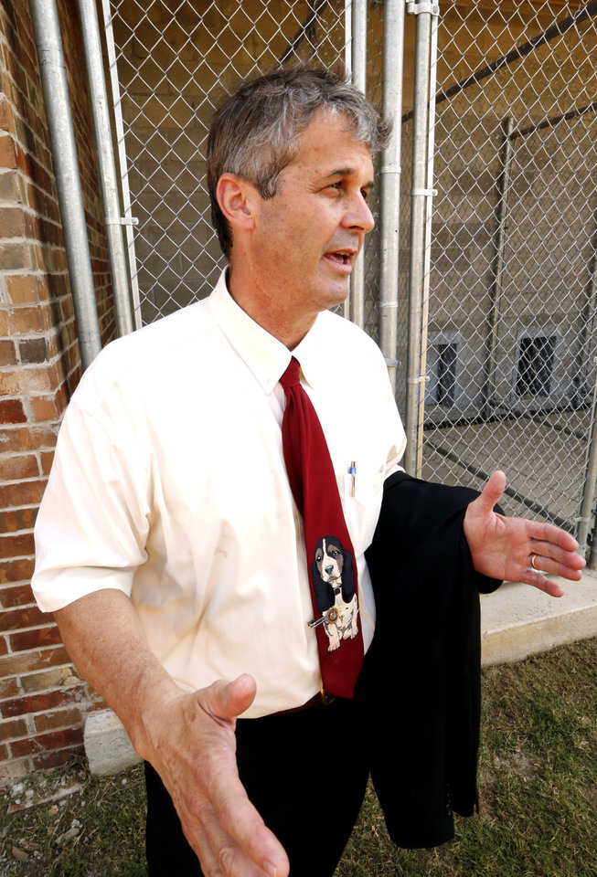 Photo -  Dr. John Otto speaks at new dog training facility at the Mabel Basset Correctional Center in McLoud.  [Photo by Steve Sisney, The Oklahoman]